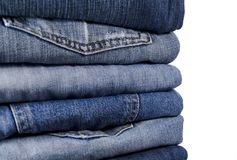 Blue jeans. Stack of blue jeans over white Stock Images