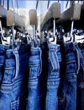 Blue jeans. Close  up of jeans on a rack Royalty Free Stock Photo