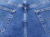 Blue jeans on back Stock Images