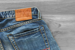 Blue jeans with back pocket and brown leather tag Royalty Free Stock Photo