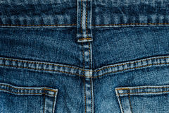 Blue jeans back pocket with a close-up. Fabric texture high resolution Stock Image