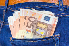 Blue jeans back pocket with euro money Royalty Free Stock Images