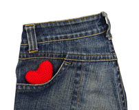 Blue jeans back pocket with red crochet heart Royalty Free Stock Photo