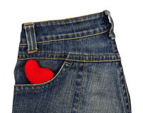 Blue jeans back pocket with red crochet heart Stock Photo