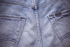Blue jeans back pockets background. With vintage filter Stock Photo