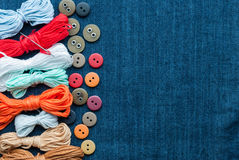Blue jeans background with buttons and threads. Royalty Free Stock Photos
