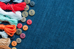 Blue jeans background with buttons and threads. Royalty Free Stock Image