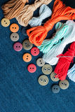 Blue jeans background with buttons and threads. Royalty Free Stock Images