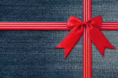 Blue Jeans background with Red Bow. Stock Images