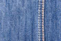 Blue jeans background with seam. Close-up of blue jeans background with seam Royalty Free Stock Photo