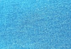 Blue jeans background. Surface of the blue jeans royalty free stock photography