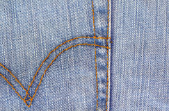 Blue jeans background with threads seam Royalty Free Stock Image