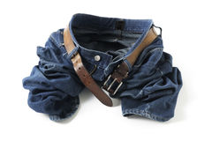 Blue jeans with belt. On white background Stock Photos