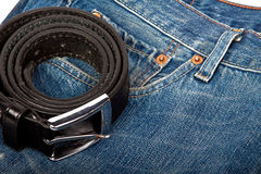 Blue jeans and belt Stock Photos