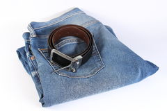 Blue jeans and belt with whitebackground. Blue jeans and belt isolated on white background.Belt top on the jeans Stock Image