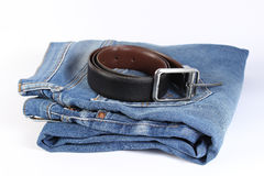 Blue jeans and belt  with whitebackground. Blue jeans  on white background.Belt on the jeans Stock Photography