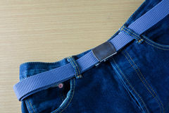 Blue jeans with belt Royalty Free Stock Image