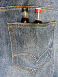 Blue-jeans with beverage Royalty Free Stock Images