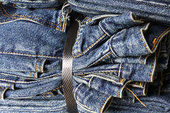 Blue Jeans binded tight together Stock Photo