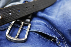 Blue jeans with black leather belt Royalty Free Stock Photo