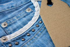 Blue jeans with blank label tag Royalty Free Stock Photos