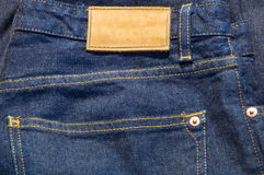Blue jeans with blank tag Royalty Free Stock Images