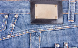 Blue jeans with bronze label Stock Photo