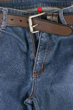 Blue Jeans with brown leather belt Stock Images