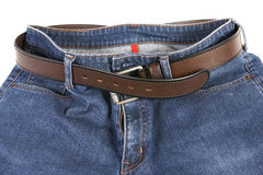 Blue Jeans with brown leather belt Royalty Free Stock Photography