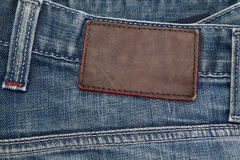 Blue jeans with brown leather tag Royalty Free Stock Images