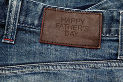 Blue jeans with brown leather tag Royalty Free Stock Photography