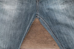 Blue jeans on a brown wooden background Stock Photo