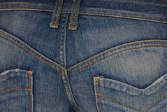 Blue jeans on buttocks stock photography