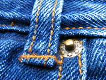 Blue jeans button Royalty Free Stock Images