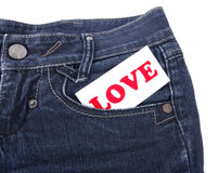 Blue jeans with card Royalty Free Stock Images