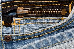 Blue jeans close up on a pocket and a zipper. Royalty Free Stock Images