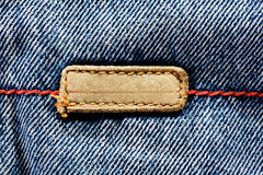 Blue jeans cloth with leather label Stock Images