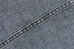 Blue jeans cloth texture with stitch. Royalty Free Stock Photos