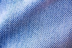 Blue jeans clothing fibers extreme macro background fine art in high quality prints products 50,6 Megapixels.  royalty free stock photo