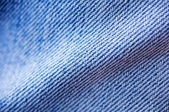 Blue jeans clothing fibers extreme macro background fine art in high quality prints products 50,6 Megapixels.  stock photo