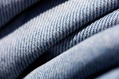 Blue jeans clothing fibers extreme macro background fine art in high quality prints products 50,6 Megapixels.  royalty free stock images