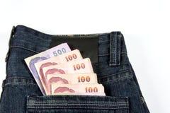 Blue jeans con contanti Fotografia Stock