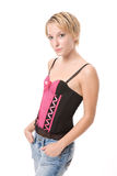 Blue Jeans and Corset Style Top. Beautiful blond young adult female in her blue jeans and pink and black corset style top Stock Photo