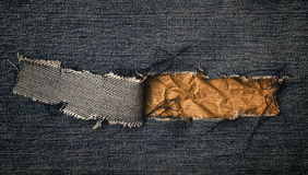 Blue jeans with crumpled paper Stock Image