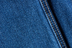 Blue jeans denim fabric texture with seam Stock Photos