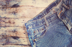 Blue jeans denim on wooden background Stock Images