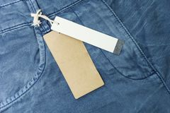 Blue jeans detail with white tag, close up royalty free stock images