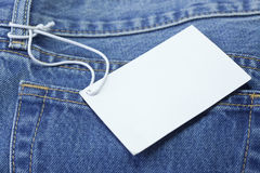 Blue jeans detail with white tag Stock Photo