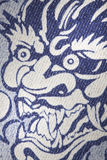 Blue jeans dragon pattern Royalty Free Stock Images