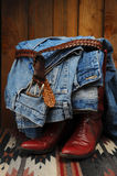 Blue Jeans draped over Cowboy Boots Royalty Free Stock Photos